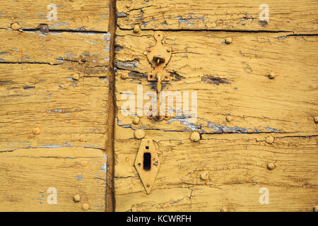 SAINT-LEONARD-DE-NOBLAT, FRANCE - 22 JULY, 2017: Detail of old and distressed wooden planks, with weathered yellow - Stock Photo