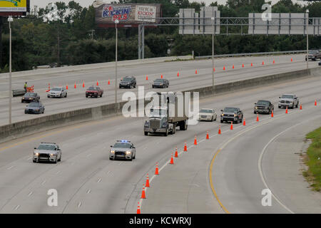 Patrolmen with the S.C. Highway Patrol lead the first vehicles down interstate I-26 westbound after the lane reversal - Stock Photo