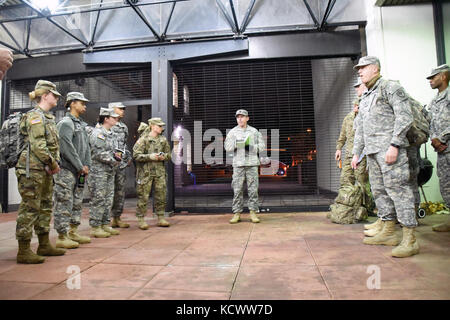 Soldiers with the South Carolina National Guard receive an early morning briefing before heading downtown to support - Stock Photo