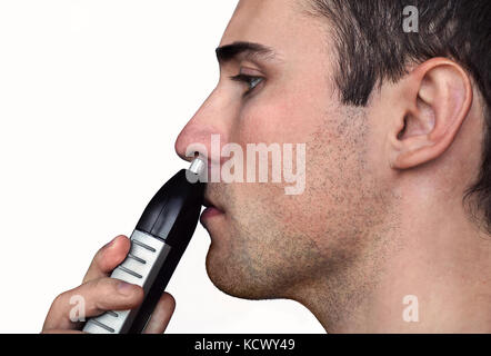Close up man portrait with trimmer near his nose on an isolated white background. - Stock Photo