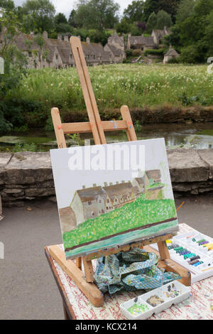 Work in progress painting on easel of Arlington Row, Bibury, Gloucestershire, England, United Kingdom, Europe - Stock Photo