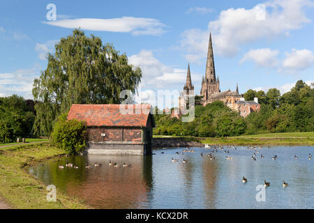 Lichfield Cathedral and Stowe Pool with boathouse, Lichfield, Staffordshire, England, United Kingdom, Europe - Stock Photo