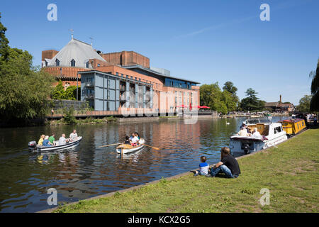 Rowing boats on the River Avon with the Royal Shakespeare Theatre, Stratford-upon-Avon, Warwickshire, England, United - Stock Photo