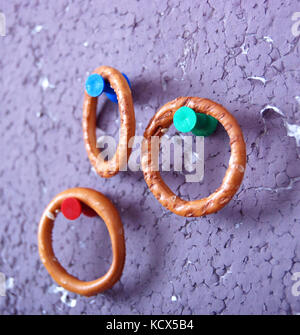 Picture of a ring crackers hanged on a pushpin - Stock Photo