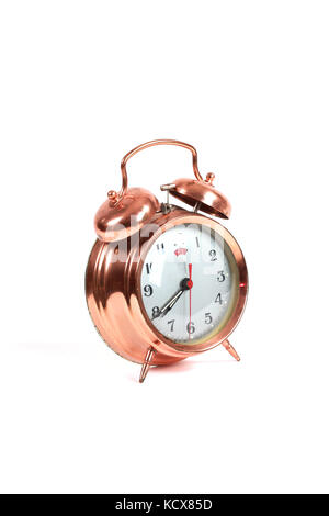 picture of a copper old style alarm clock isolated on white - Stock Photo