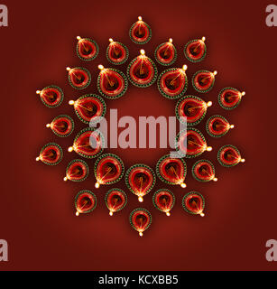 Stock photo of diwali greeting card showing top view of illuminated diya or oil lamp or panti forming a design or - Stock Photo