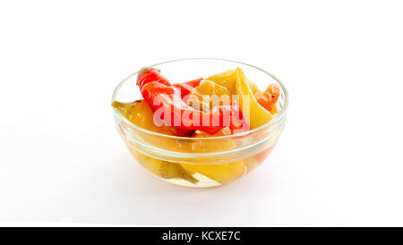 picture of a Isolated glass bowl with conserved chilli paprika - Stock Photo