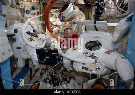 Expedition 53 American astronaut Randy Bresnik prepares his spacesuit for a spacewalk onboard the International - Stock Photo