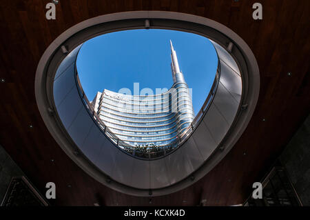 Milan: spire of the Unicredit Tower, the tallest italian skyscraper designed by Cesar Pelli, headquarters of UniCredit - Stock Photo