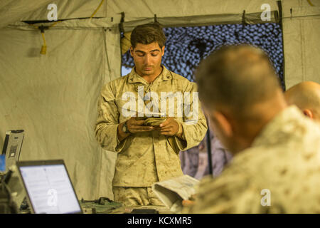 U.S. Marine Corps Lance Cpl. Logan Stutte, a gunman with Regimental Surveillance & Target Acquisition Company (RSTAC), - Stock Photo