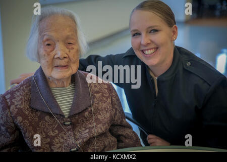 ASAN Taylor Humphreys with USS Essex joined senior citizens at the Mercy Housing, Mission Creek Senior Community - Stock Photo