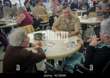 U.S. Navy Cmdr. Jeffrey Plummer, Command Chaplain of USS Essex, joined senior citizens at the Mercy Housing, Mission - Stock Photo