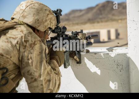 U.S. Marine Corps Lance Cpl. Austin Morris, a gunman with Regimental Surveillance and Target Acquisition Company - Stock Photo