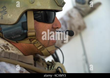 U.S. Marine Corps Gunnery Sgt. Dennis Everett, a company operations chief with Regimental Surveillance and Target - Stock Photo