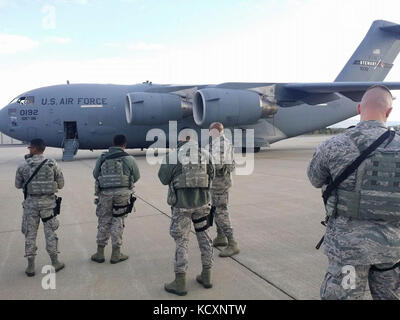 New York Air National Guard Airmen assigned to the 105th Airlift Wing's Base Defense Squadron wait to board one - Stock Photo