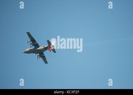 Lucas Oil Airshows plane flies beneath an Air Force C-130 during the San Francisco Fleet Week Air Show Oct. 7, 2017. - Stock Photo