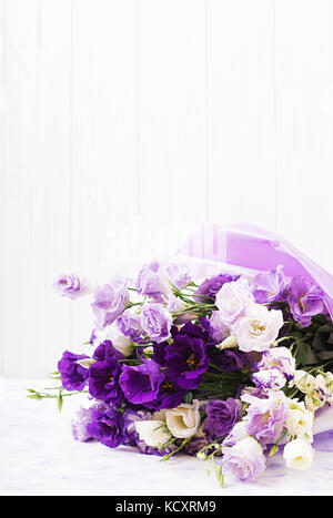 Beautiful flowers bouquet mix of white, purple and violet eustoma. - Stock Photo