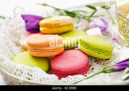 Colorful macaroons and marshmallows on a ligth  background. - Stock Photo