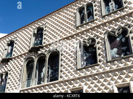Casa dos Bicos built in early 16th century in Italian Renaissance and Portuguese Manueline styles is now the headquarters - Stock Photo