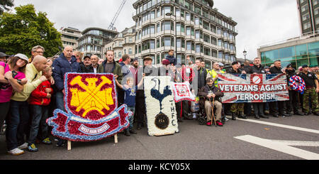 London,UK. 7 October 2017. West Ham United and Spurs supporters  with Veterans against Terrorism on Park Lane ahead - Stock Photo