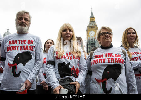 London, UK. 7th October, 2017. Campaigners against the ivory trade take part in a silent protest in Parliament Square - Stock Photo