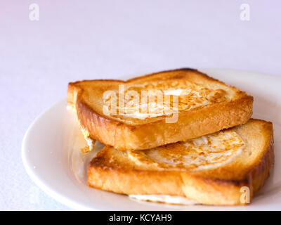 Toasted bread fried with egg inside - Stock Photo