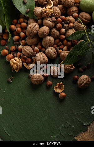 Harvest of organic nuts on wood background, food closeup - Stock Photo