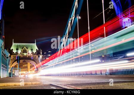 Traffic whizzing across Tower Bridge in London, the UK.