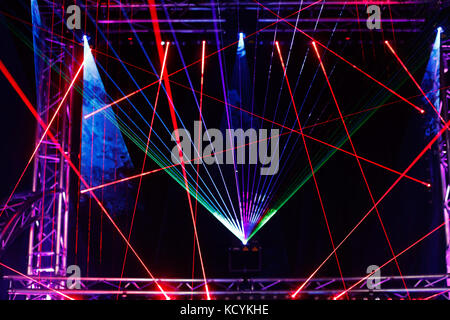 Laser light show on the club stage. - Stock Photo