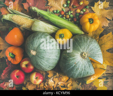 Fall vegetables assortment over wooden table background - Stock Photo