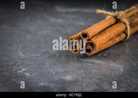 star anise and cinnamon on the gray background. - Stock Photo