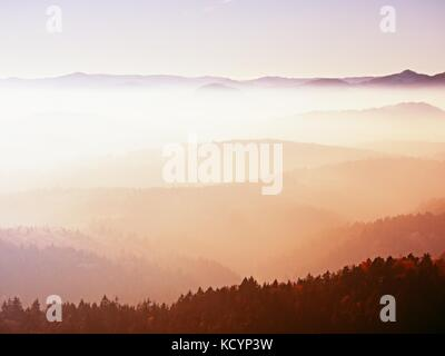View on a big rounded hill from plane, beautiful fantastic view. Fantastic dreamy sunrise, mountain above misty - Stock Photo
