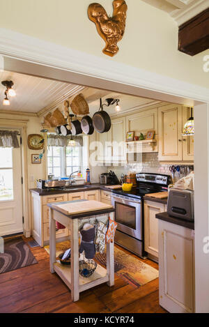 Country kitchen inside an old reconstructed 1886 Canadiana cottage style residential home, Quebec, Canada - Stock Photo
