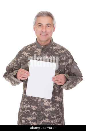 Mature Soldier Holding Blank Paper Isolated On White Background - Stock Photo