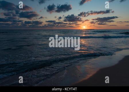 Hot summer evening sunset at the sea in Falasarna beach - Stock Photo