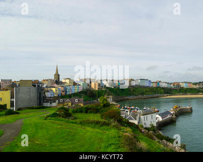 View over harbour and popular Welsh seaside town from Castle Hill Tenby Pembrokeshire South West Wales - Stock Photo