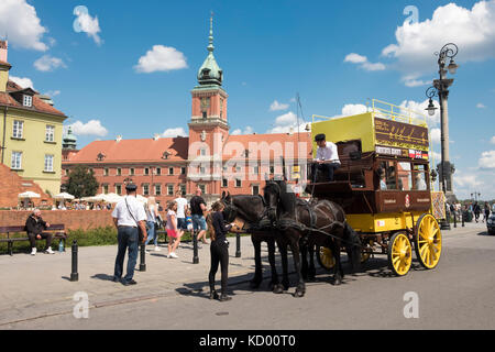 Omnibus Konny, a horse drawn carriage which takes tourists on a tour of Warsaw Old town, Poland. - Stock Photo