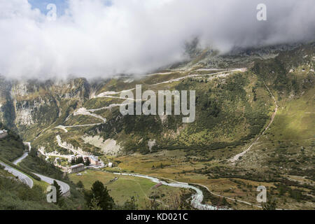 Grimsel Pass, Switzerland. The Grimsel Pass with Gletsch, and the Hotel Glacier Du Rhone, in the foreground. - Stock Photo