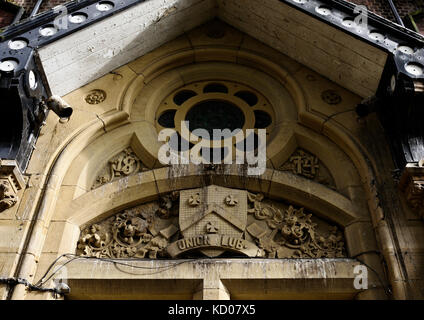 Pigeon droppings on ornate carved stonework in bury lancashire - Stock Photo