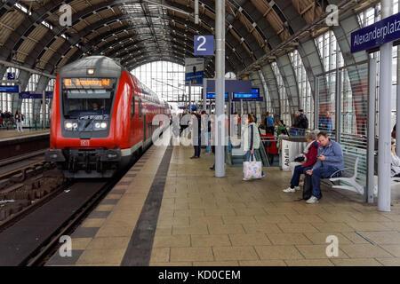 Passengers on platform at Alexanderplatz station in Berlin, Germany - Stock Photo