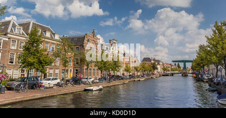 Panorama of historic buildings at a canal in Leiden, Netherlands - Stock Photo