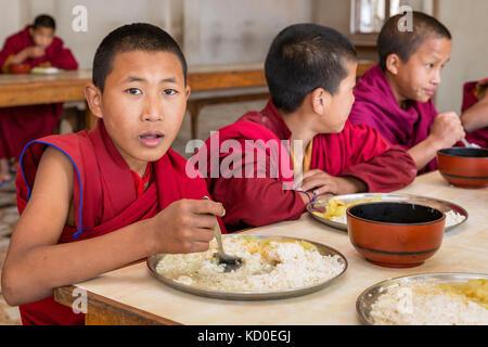 Young monks in Amitabha Monastery having lunch, Kathmandu Valley, Kathmandu, Nepal - Stock Photo