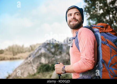 Portrait of man hiking, looking away smiling, Krakow, Malopolskie, Poland, Europe - Stock Photo
