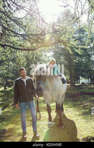 Couple in woodland horse riding, Tirol, Steiermark, Austria, Europe Stock Photo