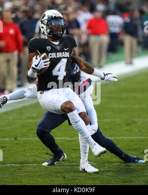 October 7, 2017: Colorado wide receiver Bryce Bobo is tackled by Arizona's Lorenzo Burns. The Wildcats won, 45-42, - Stock Photo