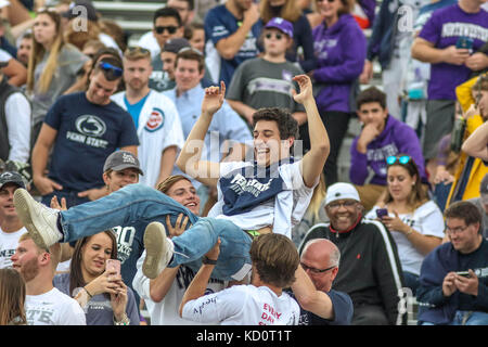 Saturday October 7th - A Penn State fan crowd surfs during NCAA football game action between the Penn State Nittany - Stock Photo