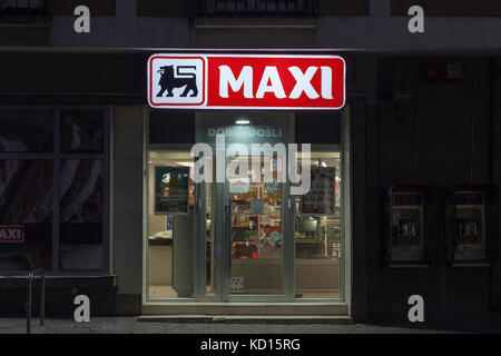 BELGRADE, SERBIA - OCTOBER 10, 2017: Entrance of a Maxi Supermarket in the evening. Belonging to the Belgian group - Stock Photo