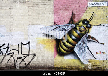 Mason Street with symbolic worker bee street art in the Northern Quarter of Manchester - Stock Photo