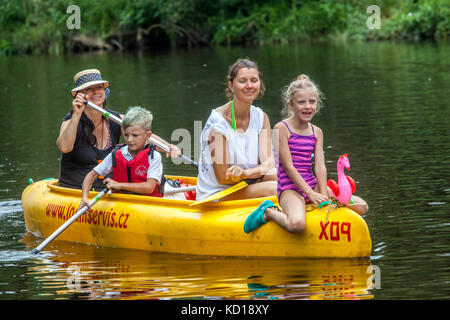 Canoeing family with three generation paddlers going down by  Otava river, People, Vacations in summer, Czech Republic - Stock Photo