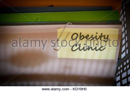 Obesity clinic written on document folder, Dorset, England. - Stock Photo